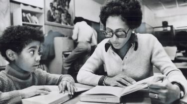 Image Description: Judith Butterfield tutors a student in mathematics at the Black education project on College St., 1975. Toronto Star Archives, Toronto Public Library, 1975.